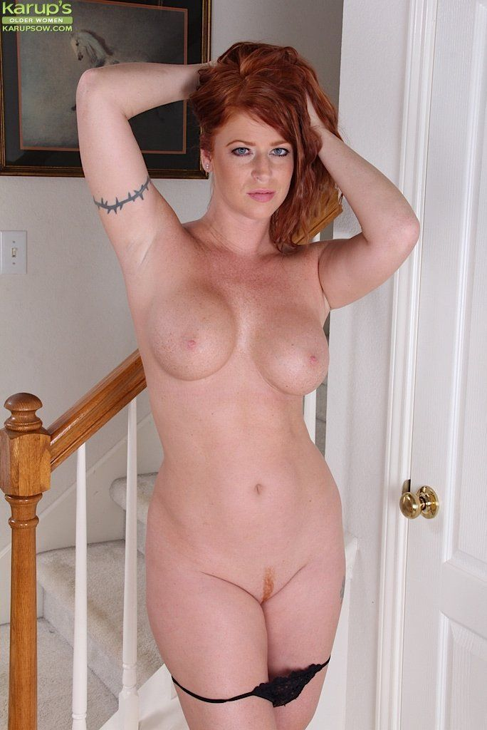Think, naked playing redhead mature with