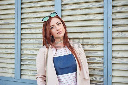 Redhead strips out of jean jacket