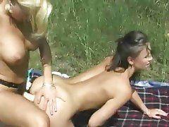 Lesbian outdoors strapon double picnic retro