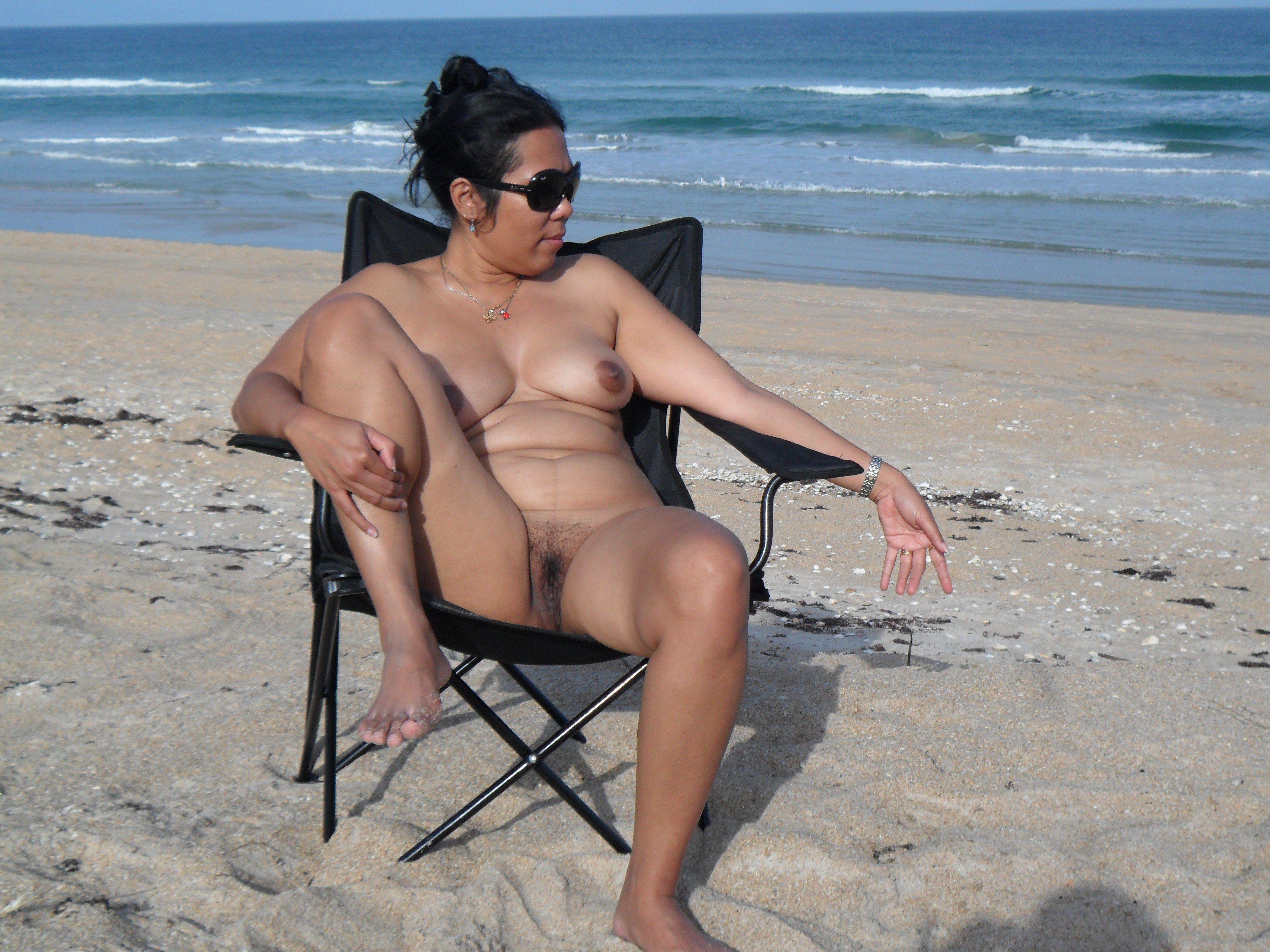 Nude beach women sunbathing